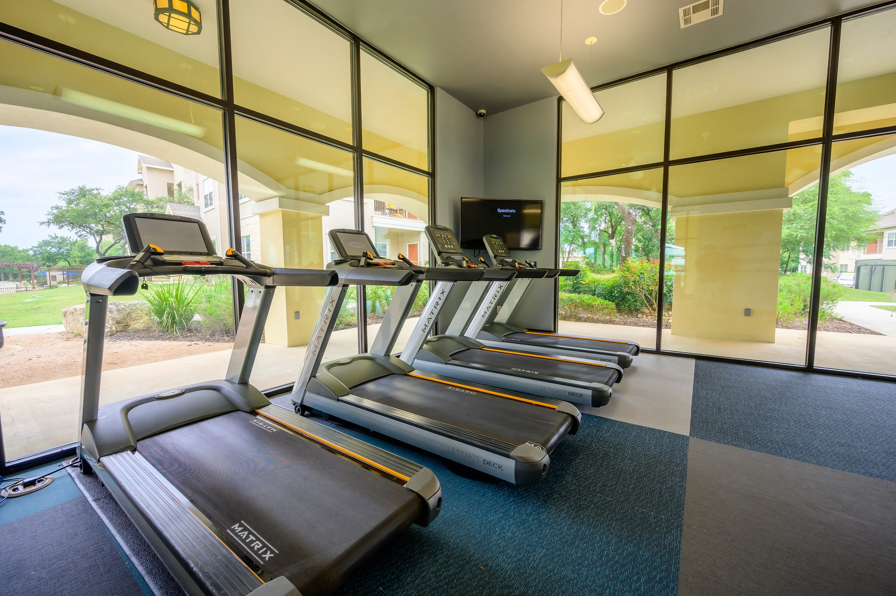 Treadmills in fitness center at Pecan Springs Apartments