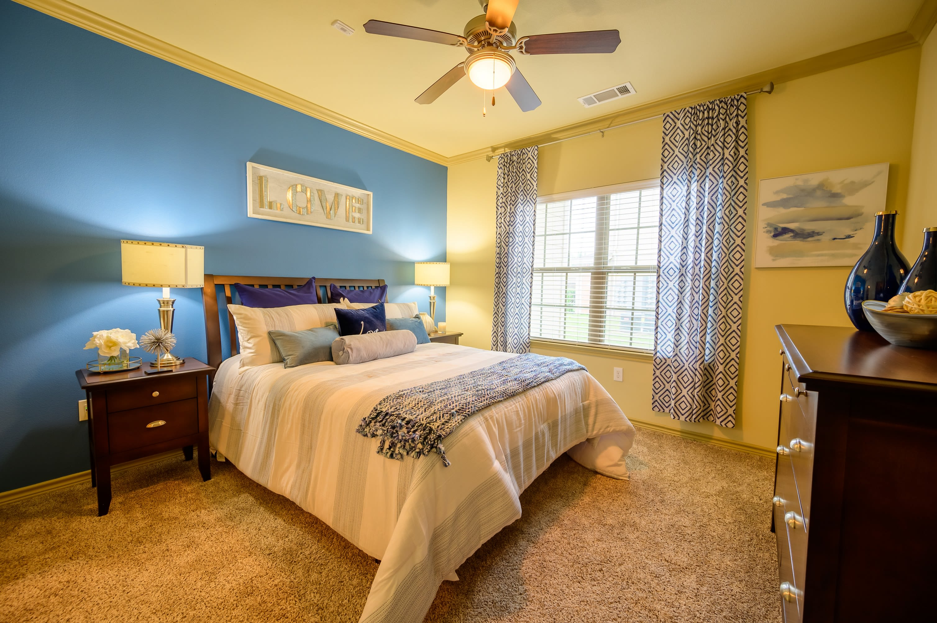 Bedroom with ceiling fan at Pecan Springs Apartments