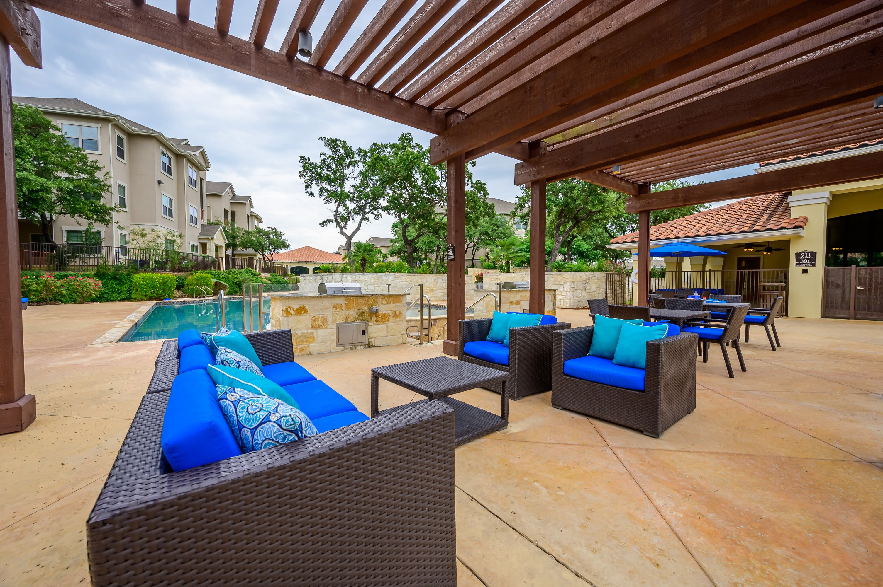 Outdoor furniture poolside at Pecan Springs Apartments