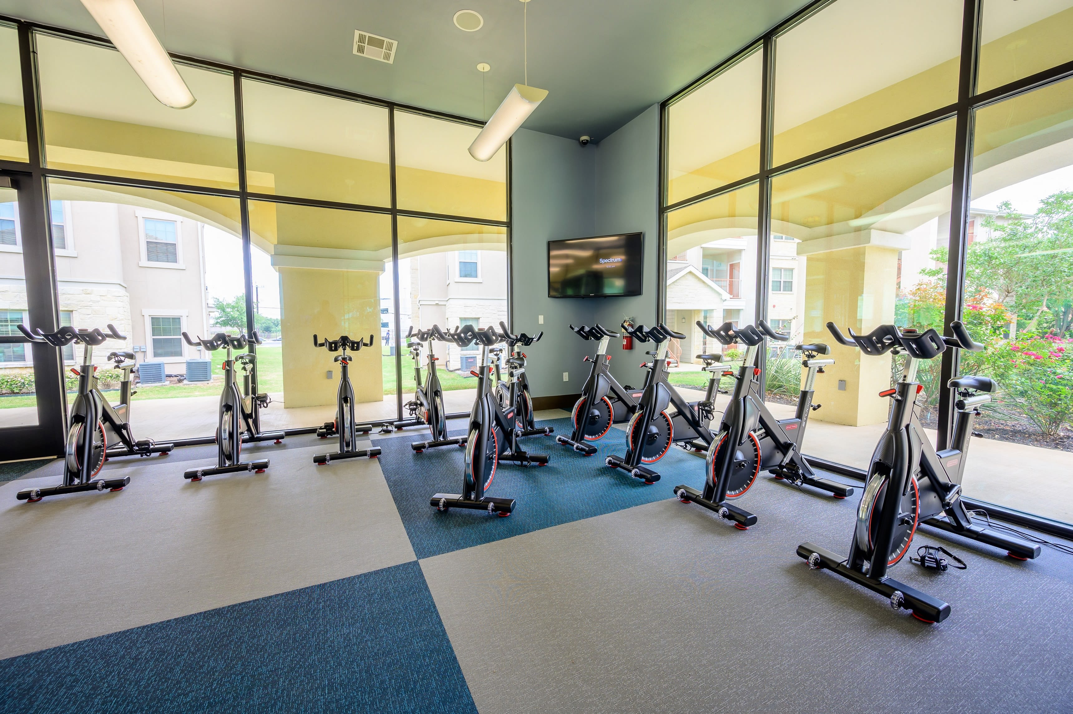 Plenty of stationary bikes in fitness center at Pecan Springs Apartments