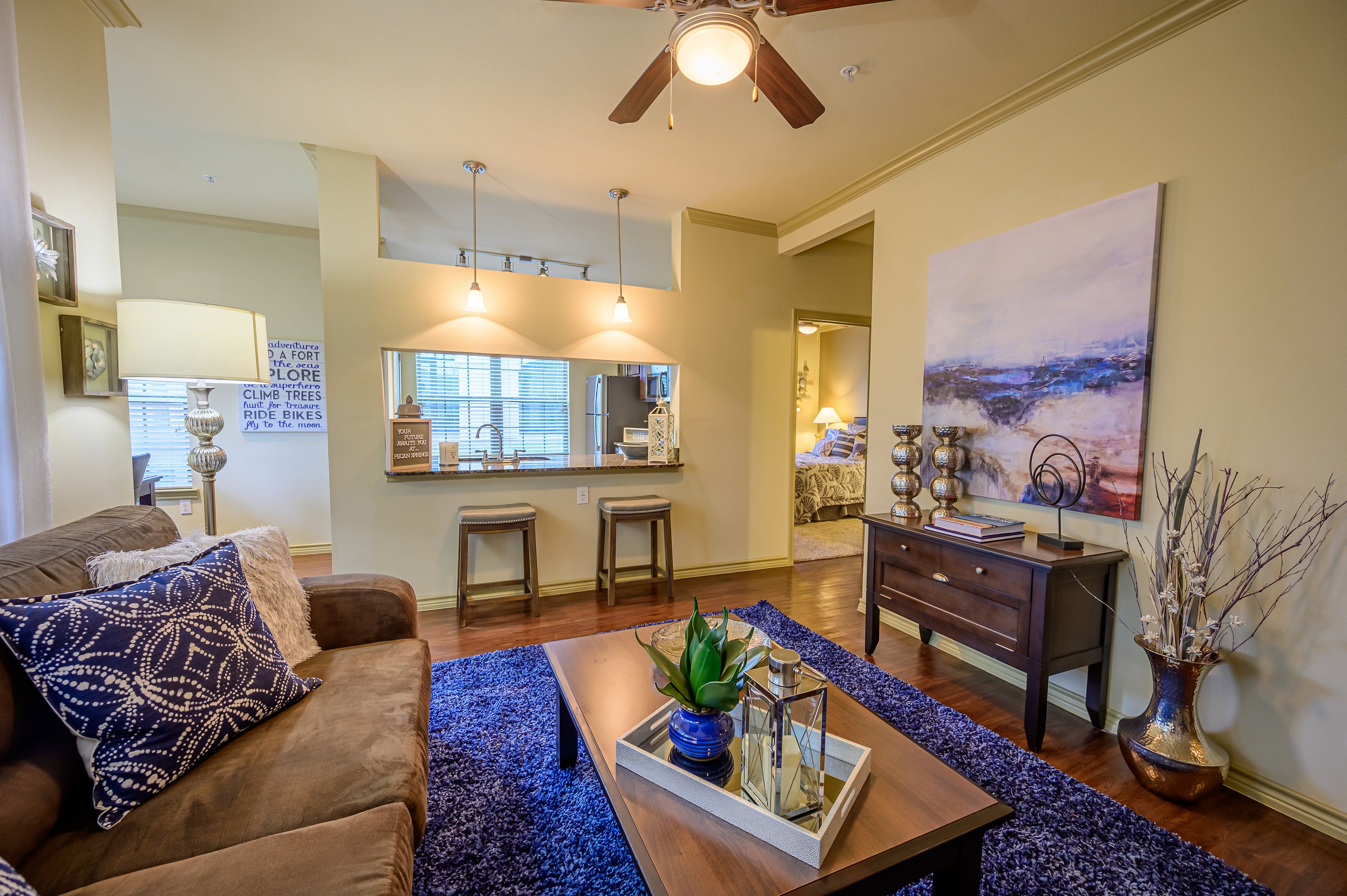 Living room with lovely wood floors at Pecan Springs Apartments