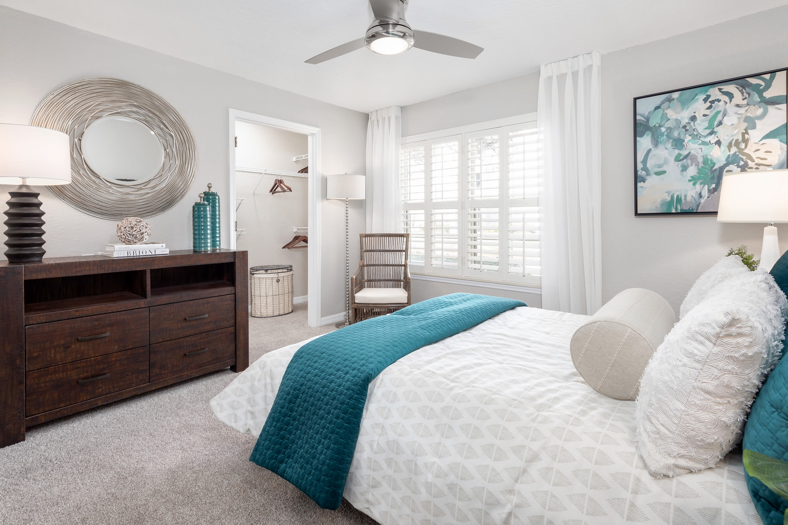Cozy and spacious main bedroom in model home at Amira at Westly in Tampa, Florida