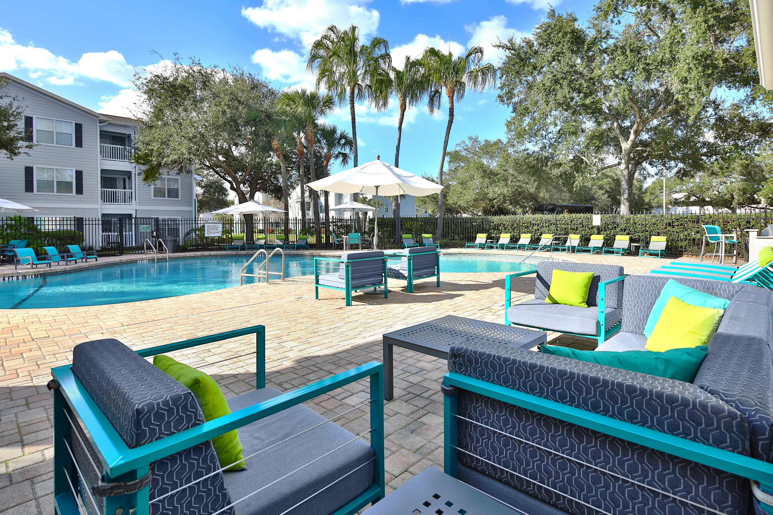 Cozy modern lounge chairs near outdoor poolside at Amira at Westly in Tampa, Florida