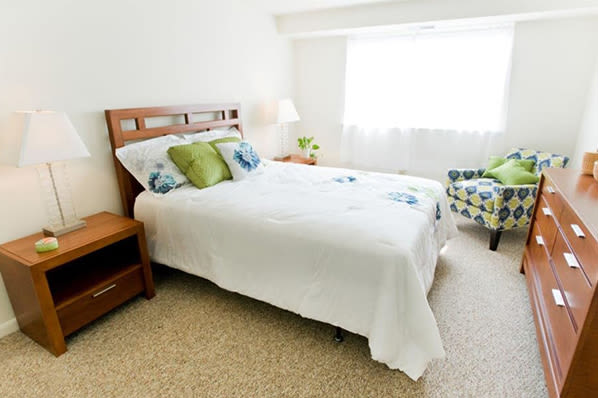 Well decorated bedroom at Strafford Station Apartments in Wayne, Pennsylvania