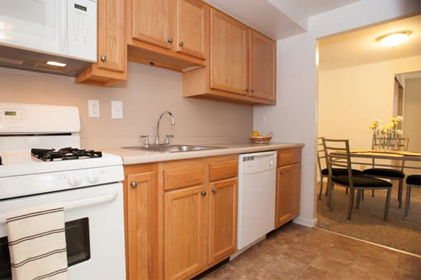 Kitchen with granite counters at Strafford Station Apartments in Wayne, Pennsylvania