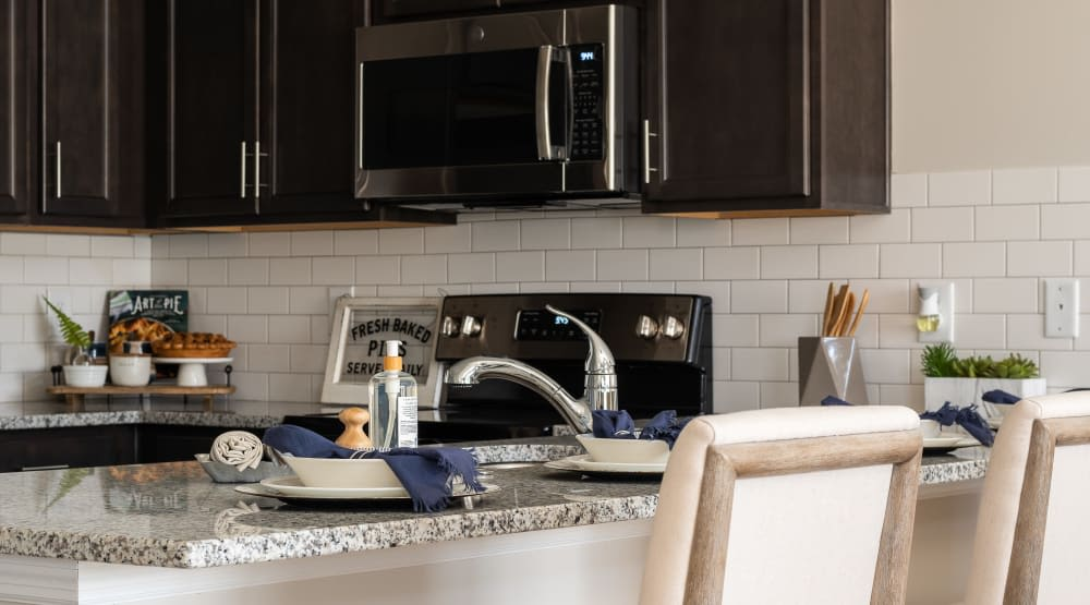 Granite style countertop with dishes on it at Randall Residence of Centerville in Centerville, Ohio