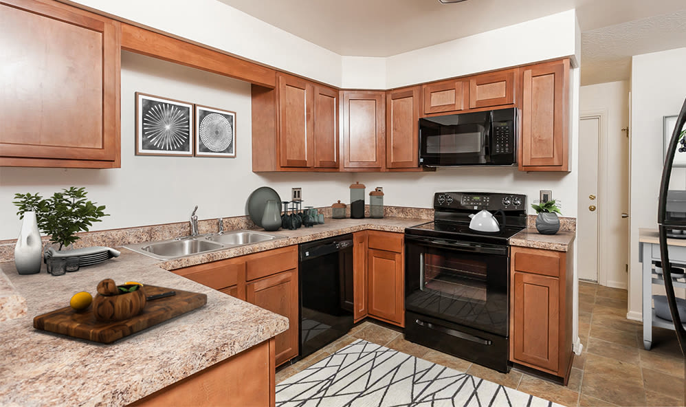 Well-equipped kitchen at CenterPointe Apartments and Townhomes home in Canandaigua, New York