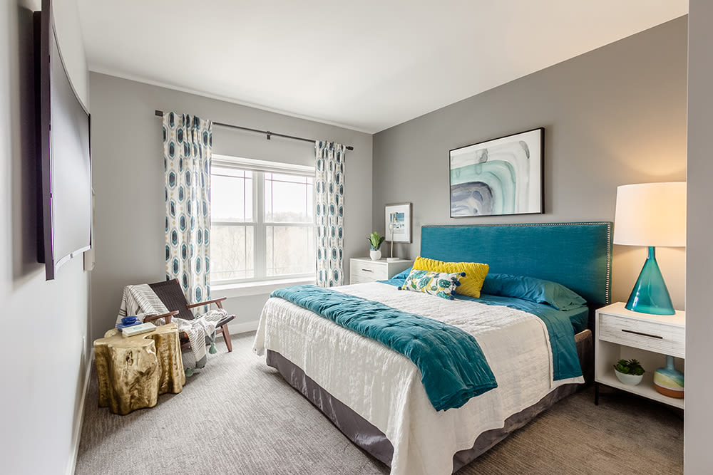 Cozy bedroom at Ellison Heights Apartments in Rochester, New York