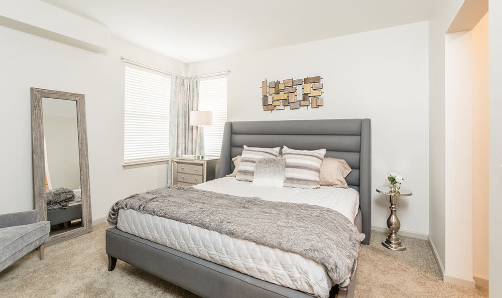 Beautifully designed master bedroom at Fairview at Town Center Apartment Homes home in Rochester, New York