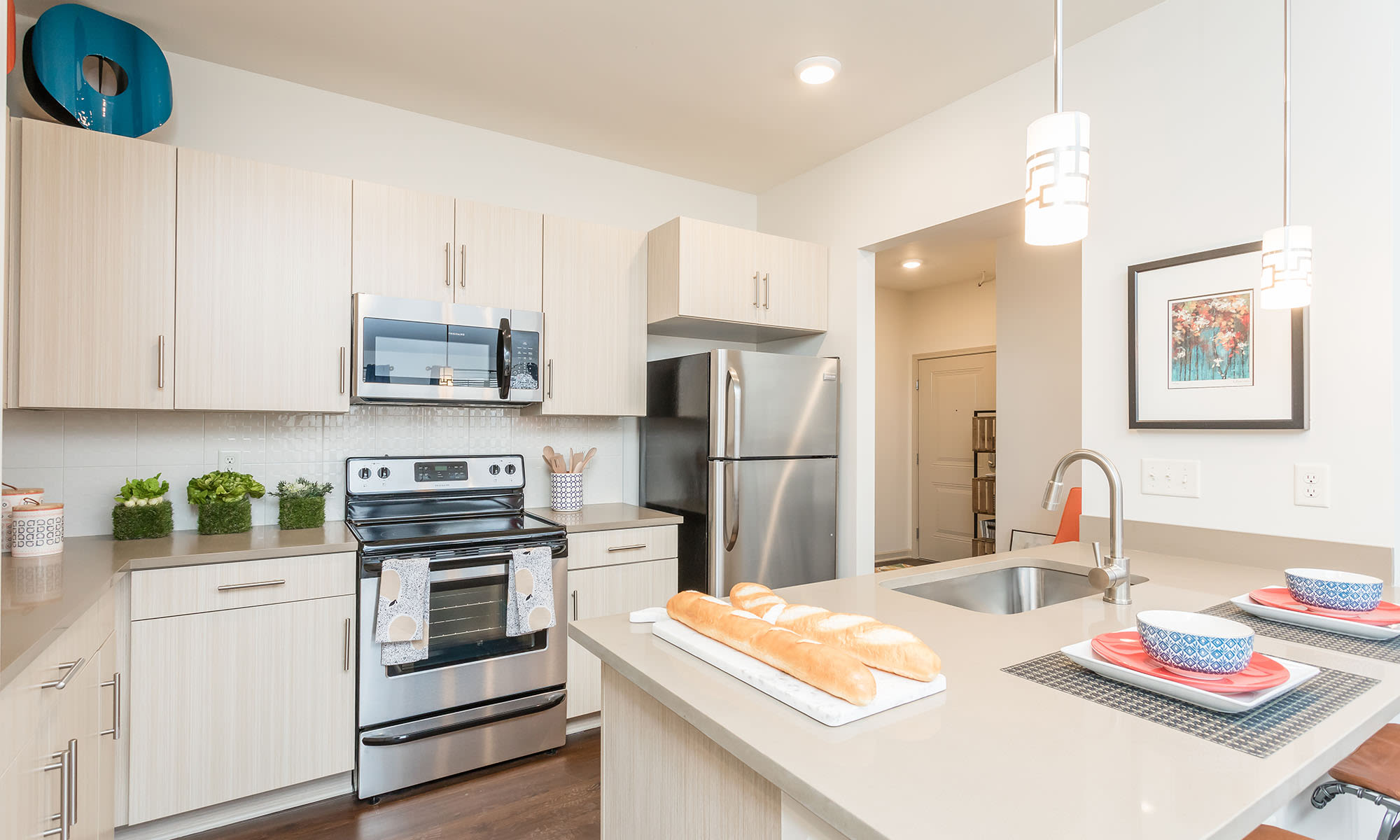 Modern kitchen with island at Fairview at Town Center Apartment Homes home in Rochester, New York