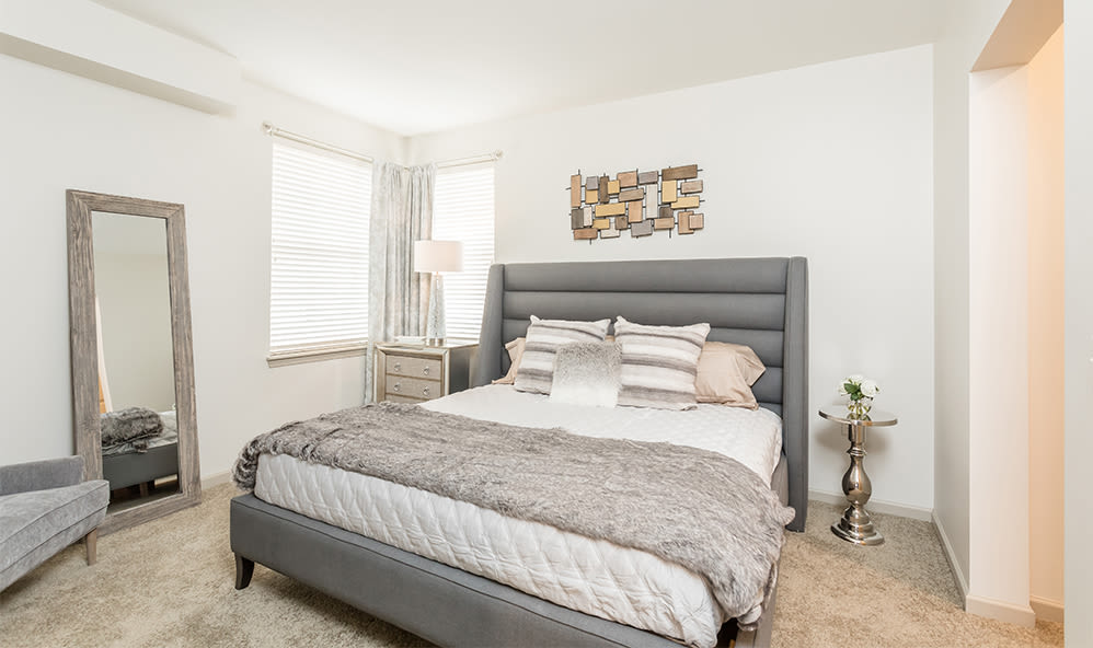 Sleep well at your bedroom at Fairview at Town Center Apartment Homes in Rochester, New York
