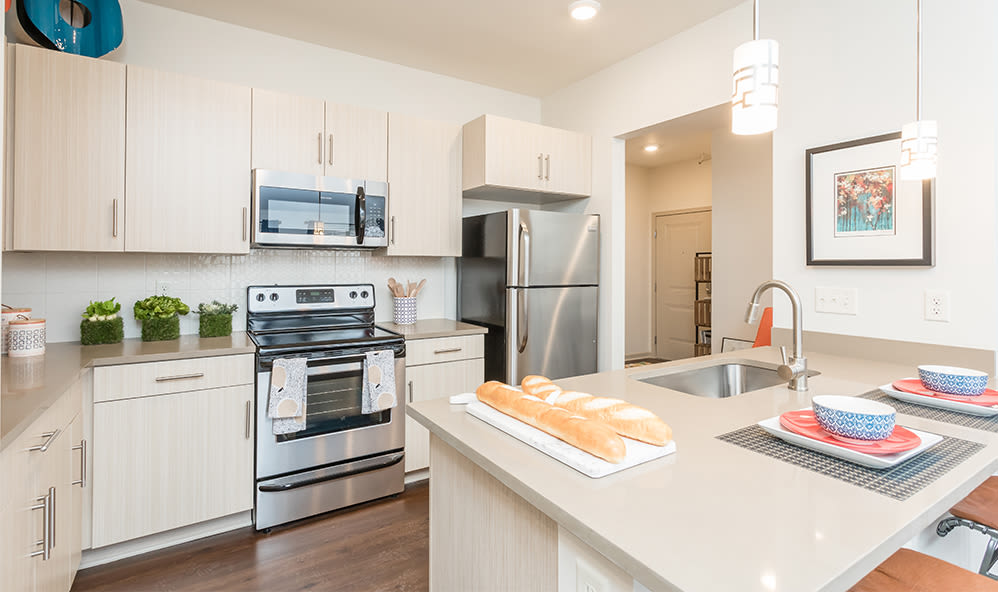 Inviting kitchen at Fairview at Town Center Apartment Homes in Rochester, New York