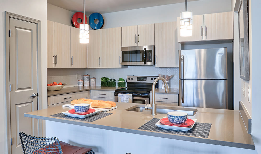 Enjoy apartments with a modern kitchen at Fairview at Town Center Apartment Homes in Rochester, New York