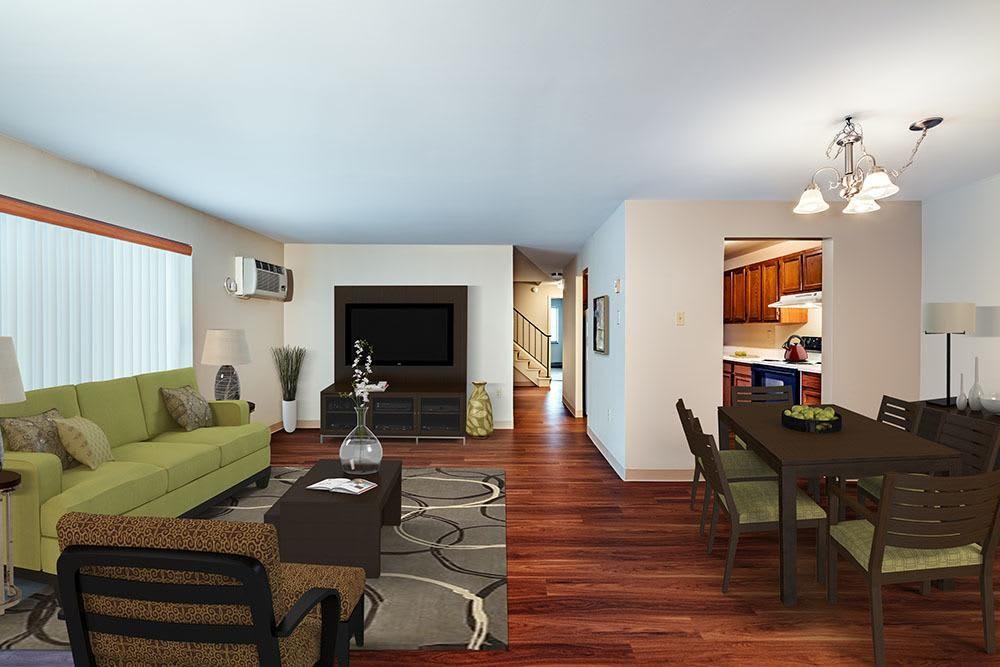 Spacious living room at Maiden Bridge & Canongate Apartments in Pittsburgh, Pennsylvania