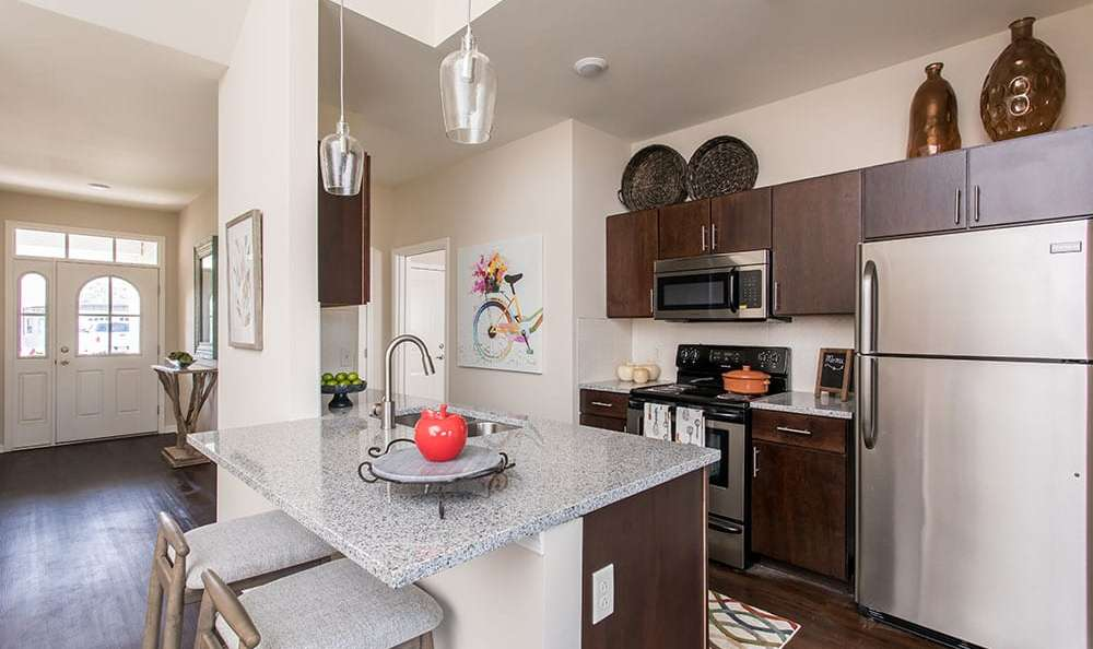 Modern kitchen with island at Orchard View Senior Apartments home in Rochester, New York