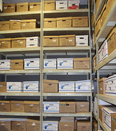 Boxes stored on shelves at StorageMax Baton Rouge in Baton Rouge, Louisiana
