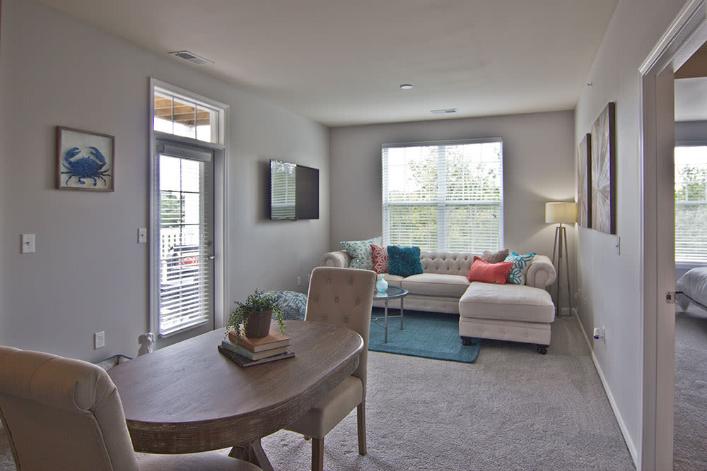 Bright living room at Overlook Apartments in Elsmere, Kentucky