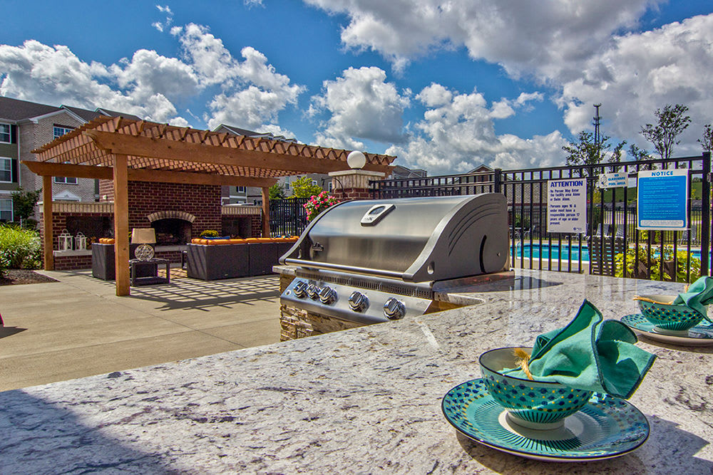 Outdoor BBQ area at Overlook Apartments in Elsmere, Kentucky