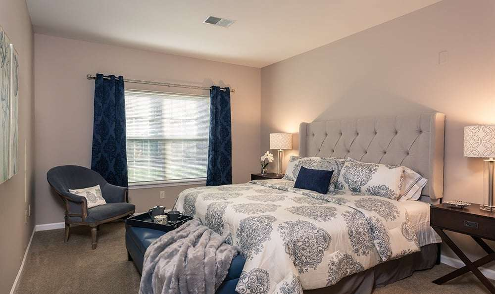 Beautifully designed bedroom at Waters Edge Apartments in Webster, New York