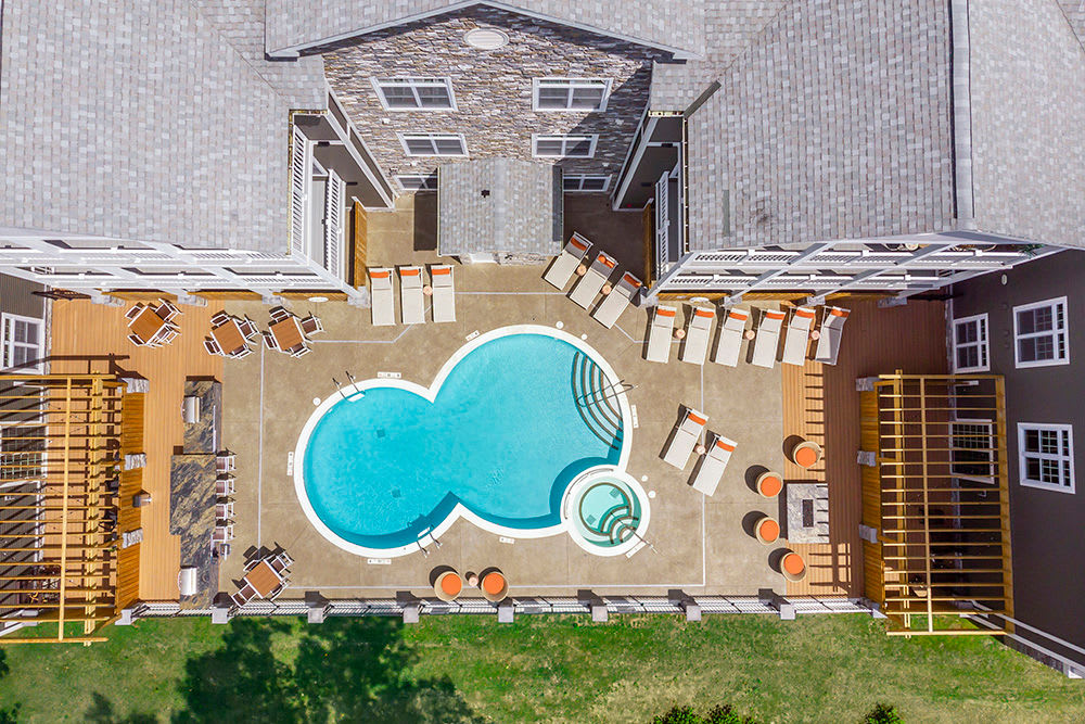 Aerial View of swimming pool and apartments at Waters Edge Apartments in Webster, New York