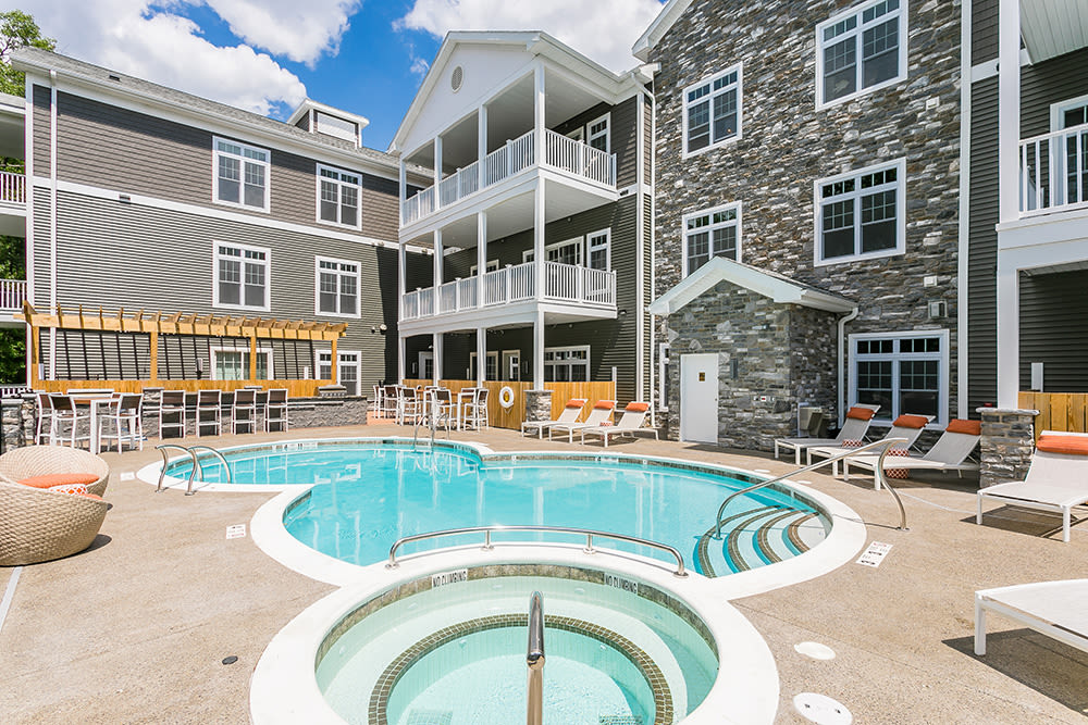 Swimming pool and hot tub at Waters Edge Apartments in Webster, New York