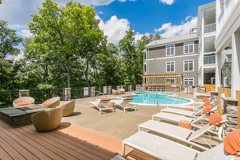 Patio seating at Waters Edge Apartments in Webster, New York