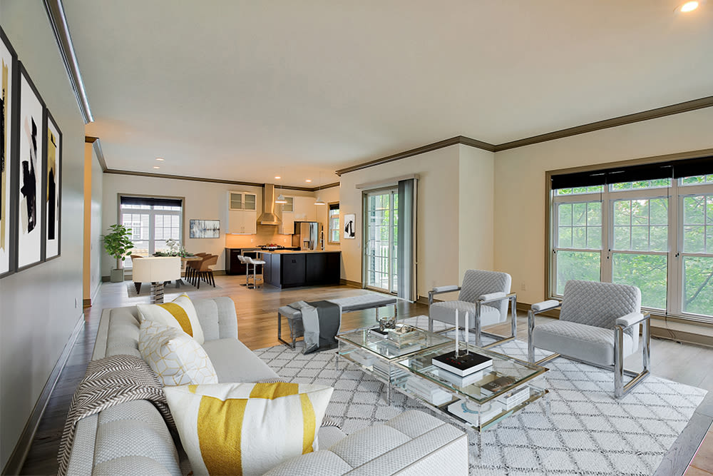 Naturally well-lit living room at Waters Edge Apartments in Webster, New York