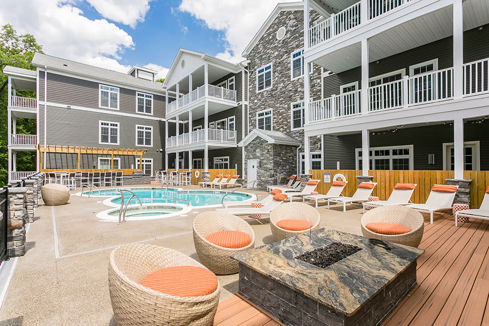 sundeck and swimming pool at Waters Edge Apartments in Webster, New York