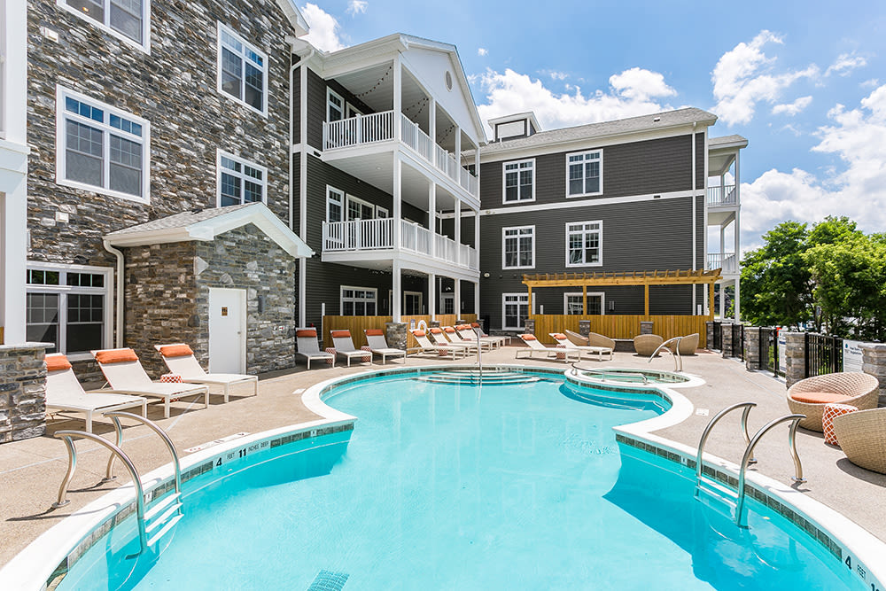 pool and patio at Waters Edge Apartments in Webster, New York