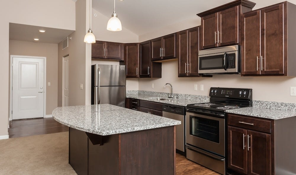 Kitchen with an island at Waters Edge Apartments in Webster, New York