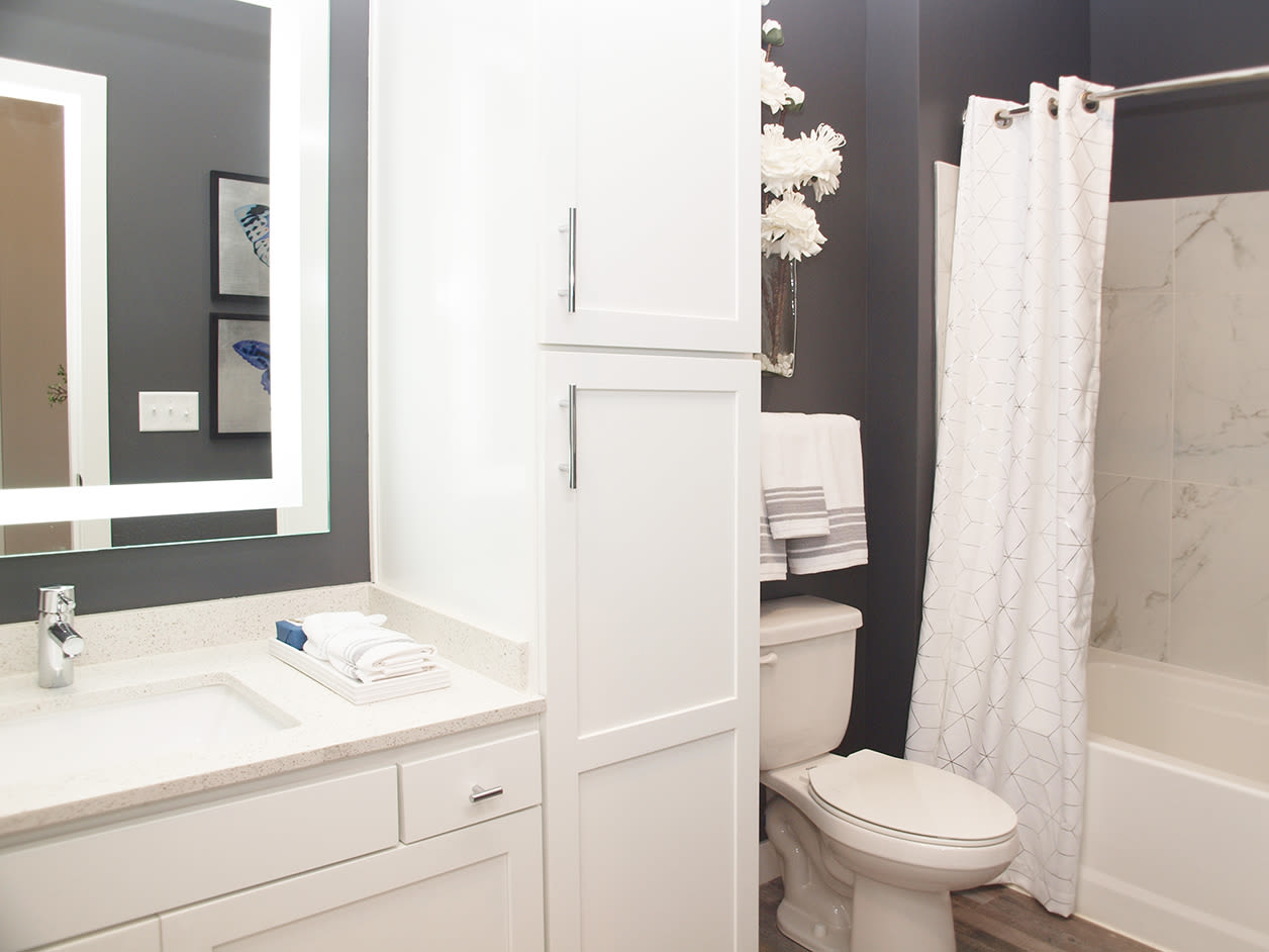 Bathroom featuring a shower and bathtub at Allure Apartments in Centerville, Ohio
