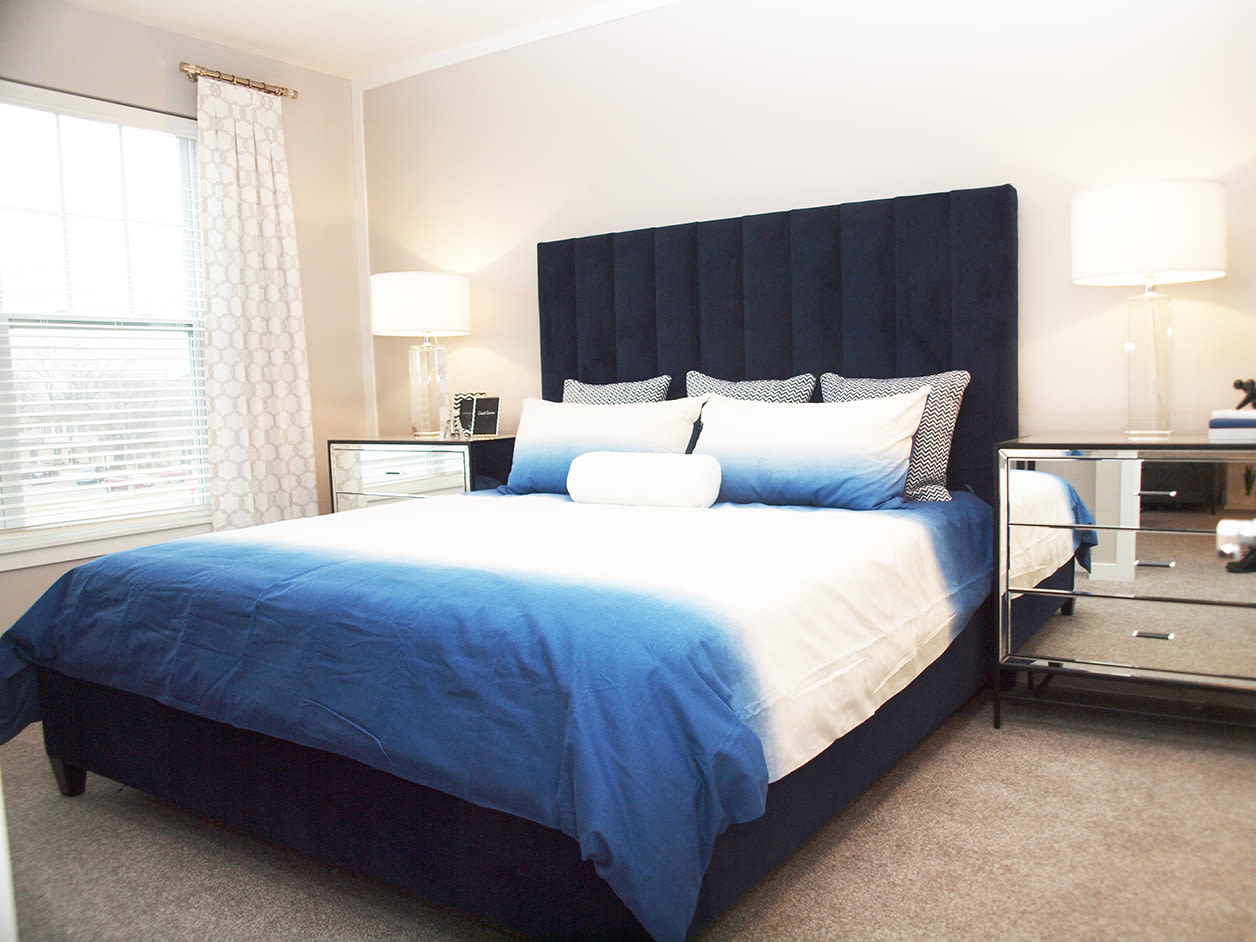 Modern bedroom at Allure Apartments in Centerville, Ohio