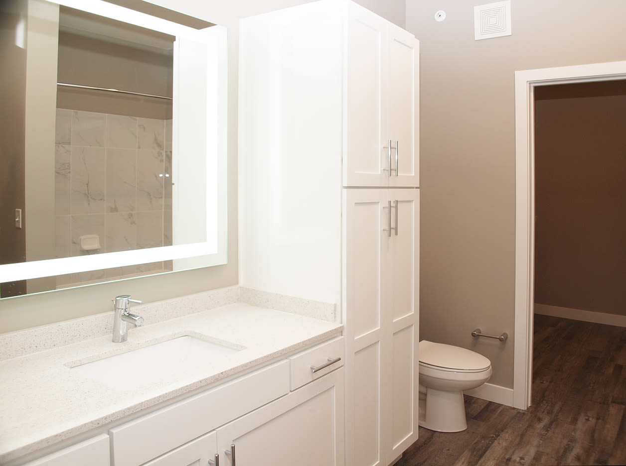 Bathroom with lots of cabinet storage at Element Oakwood in Dayton, Ohio