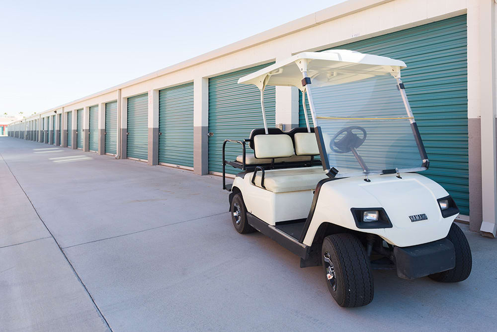 A golf cart in front of a storage unit at Chino Self Storage in Chino, California