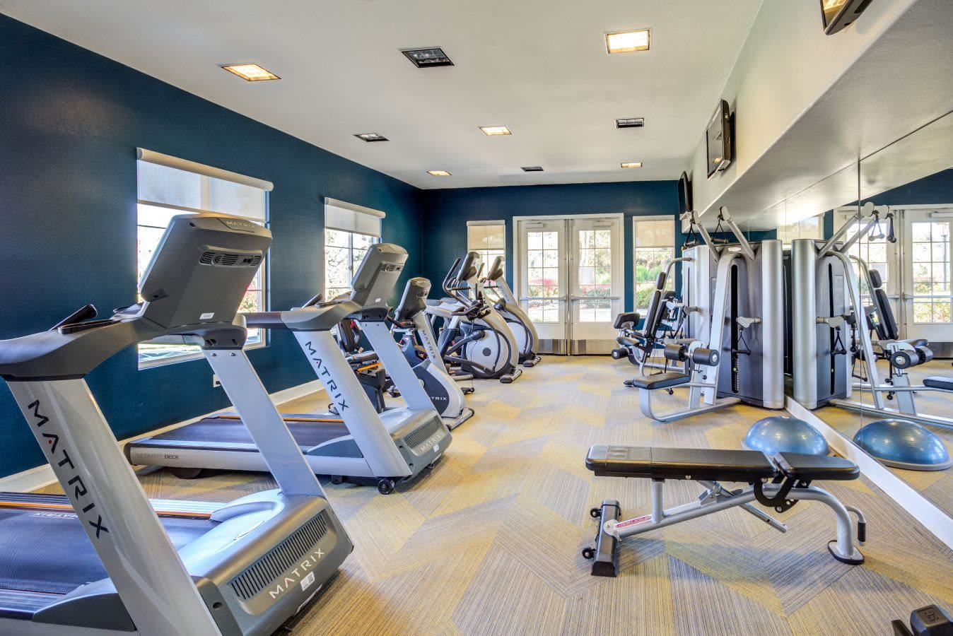 Well-equipped onsite fitness center at Sofi Highlands in San Diego, California