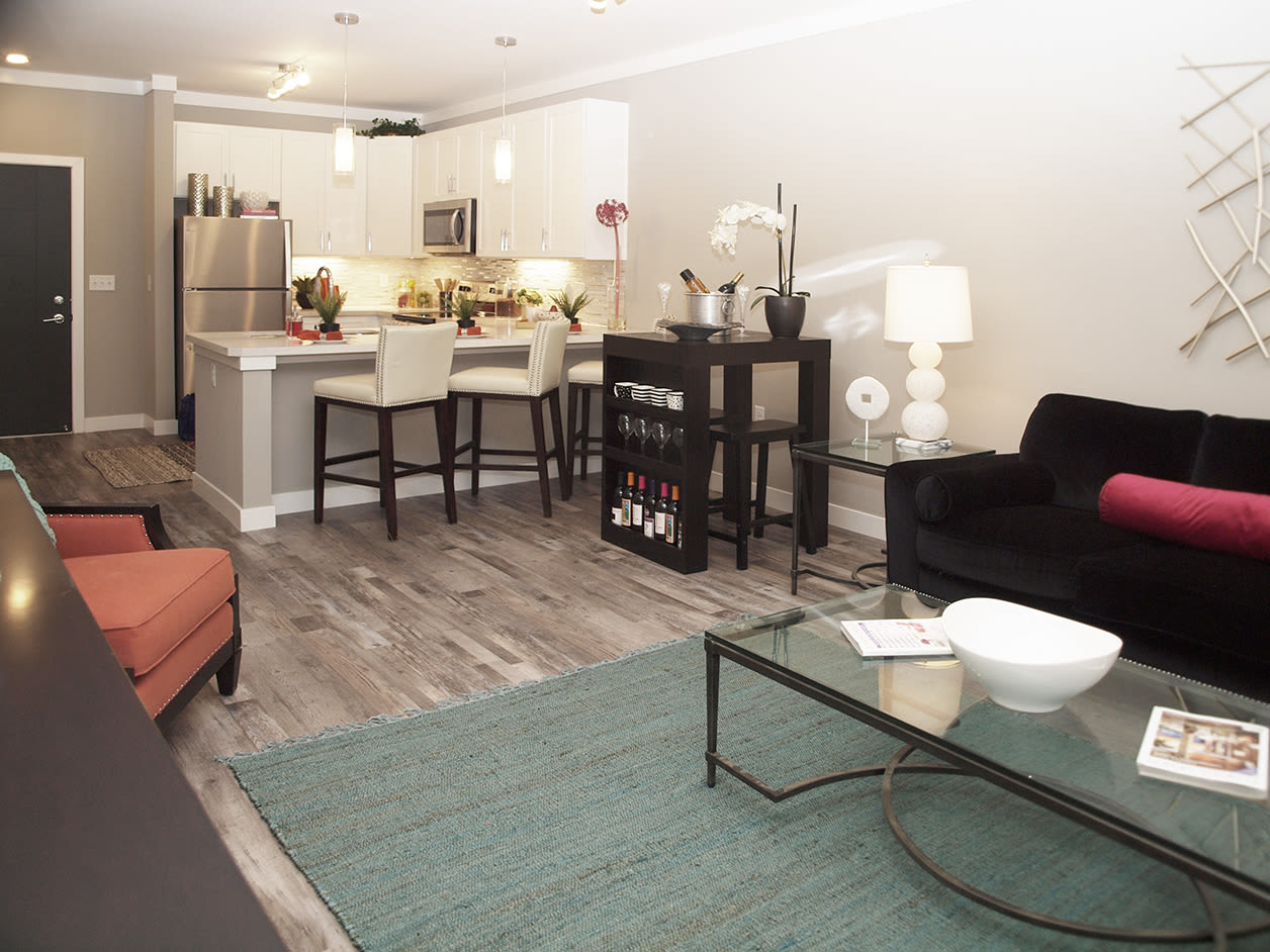 Living room and kitchen featuring breakfast bar seating at Allure Apartments in Centerville, Ohio