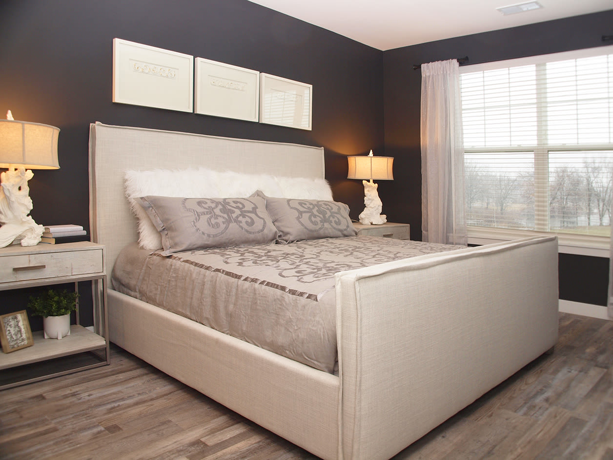 Master bedroom with large windows and lots of light at Element Oakwood in Dayton, Ohio