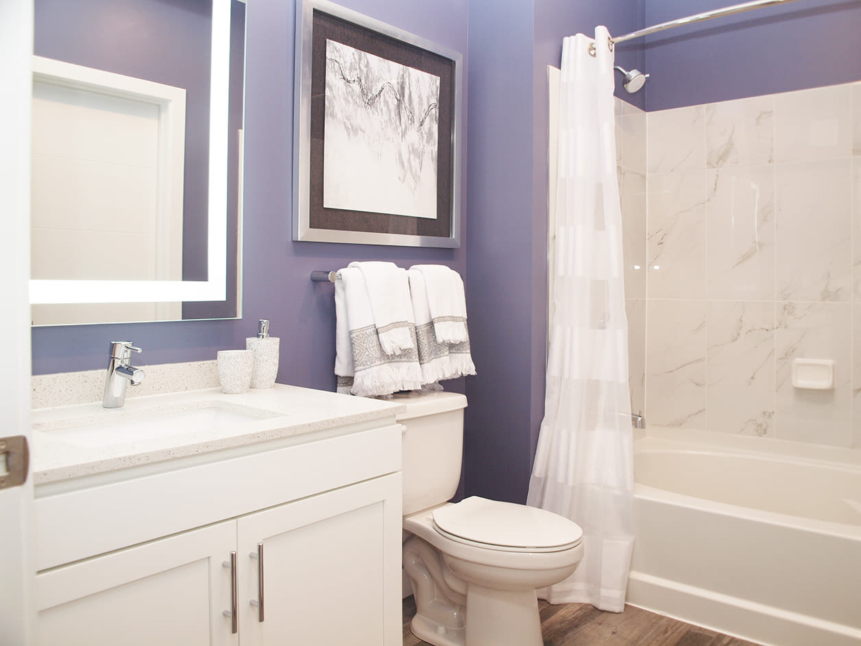 Bathroom featuring a shower and bathtub at Element Oakwood in Dayton, Ohio