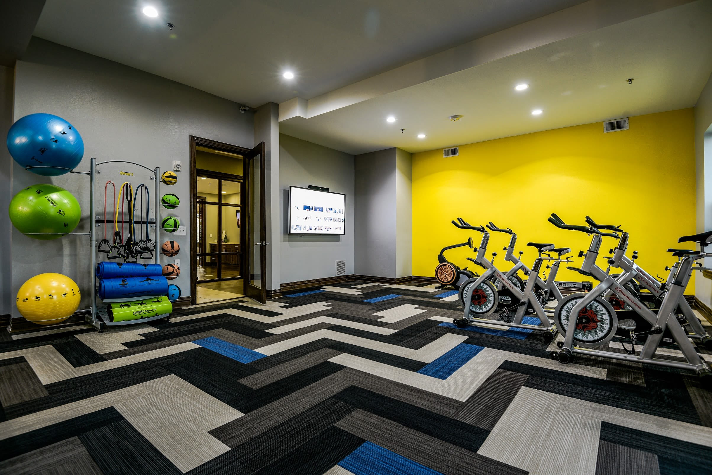 Community fitness gym with individual workout stations at The Blvd in Irving, Texas