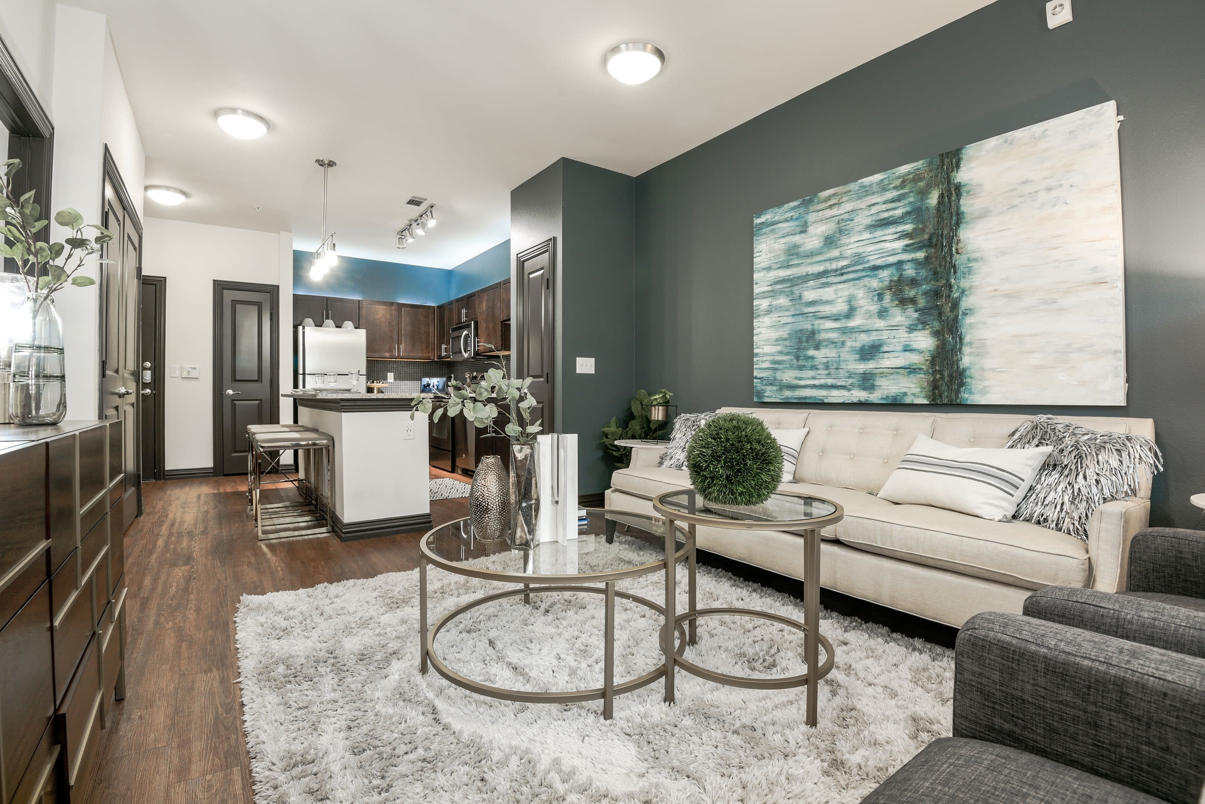 Modern decor and hardwood floors in open concept floor plan at The Blvd in Irving, Texas