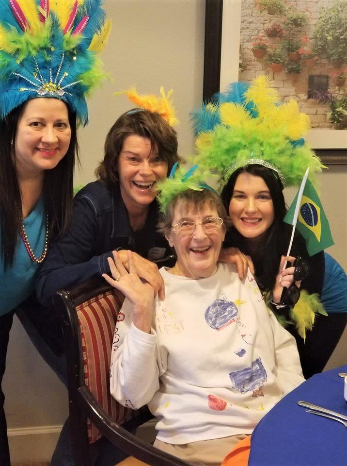 Staff and resident celebrating Brazil at Inspired Living in Bradenton, Florida.