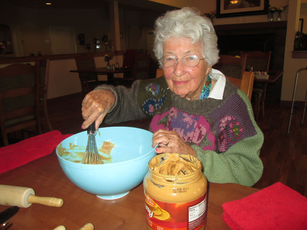 Woman working with peanut butter at Quail Park of Lynnwood in Lynnwood, Washington