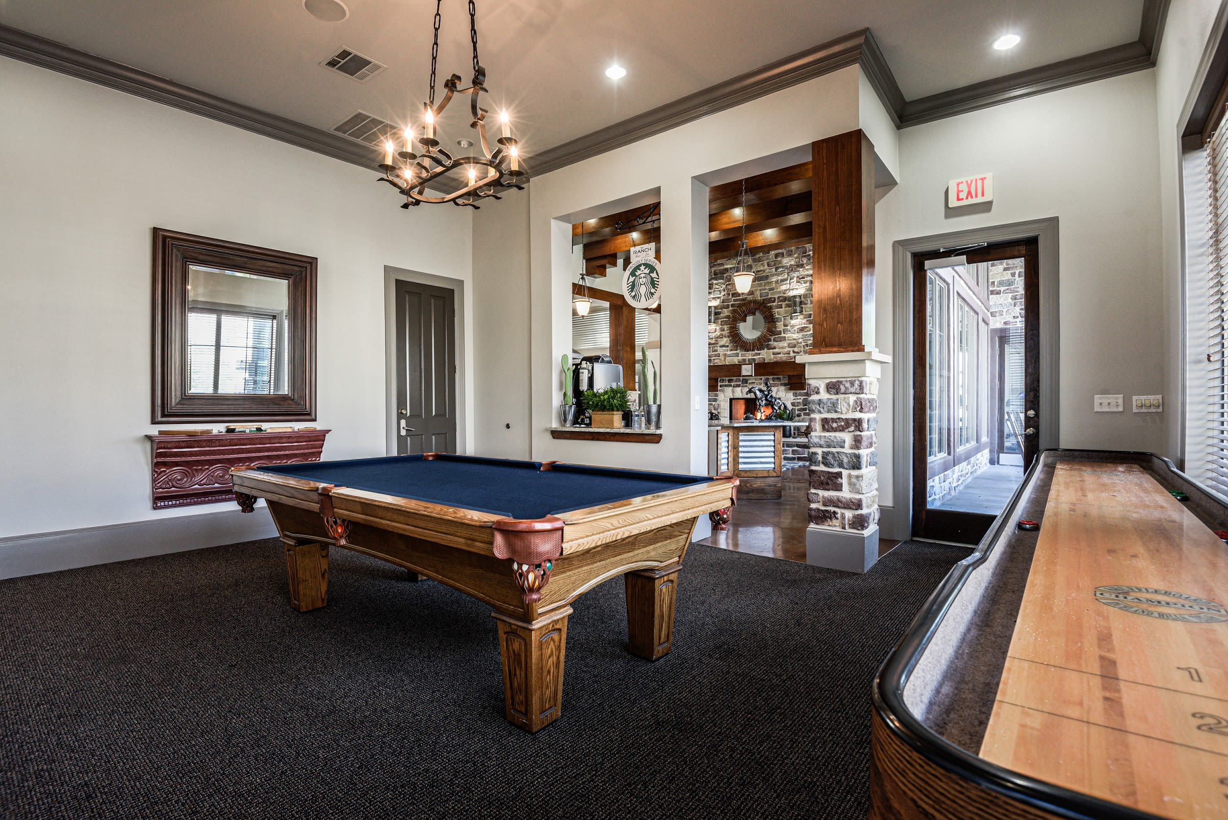 Pool table and shuffleboard tables available at Ranch ThreeOFive in Arlington, Texas