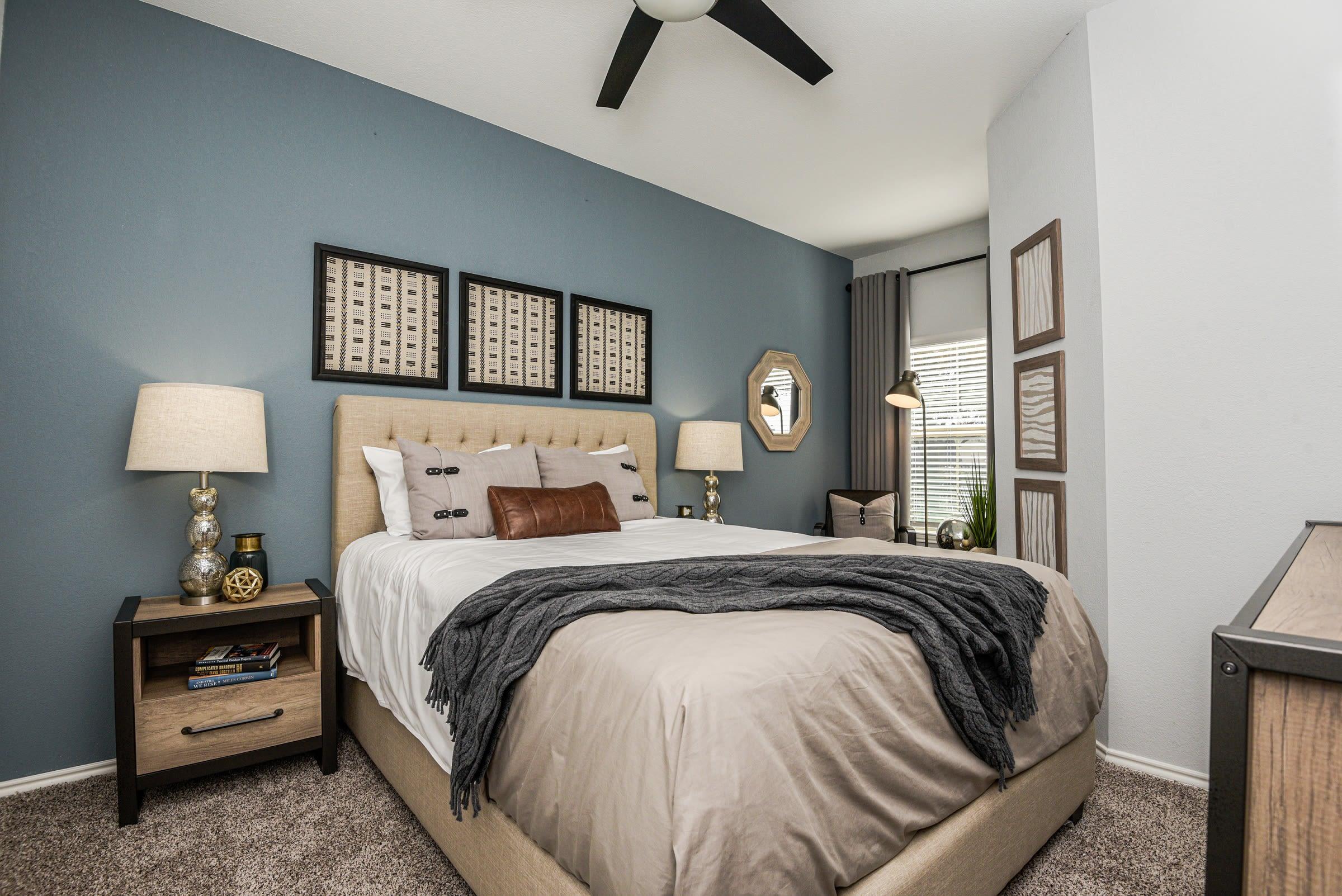 Well decorated model bedroom at Ranch ThreeOFive in Arlington, Texas