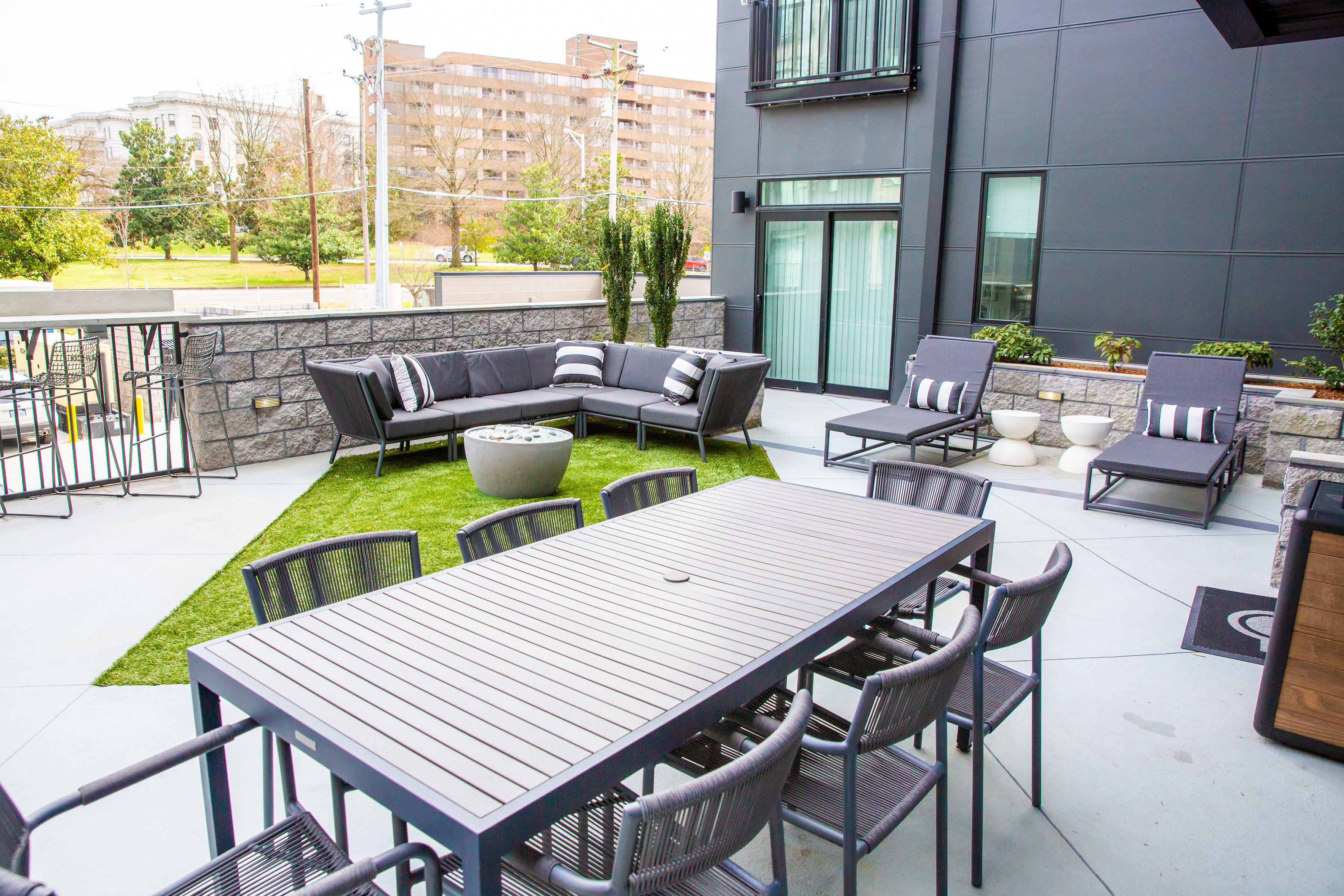 Patio and community fire pit at Belcourt Park in Nashville, Tennessee