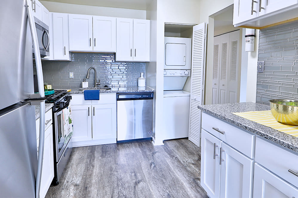 Kitchen with plenty of cabinet space at East Meadow Apartments in Fairfax, Virginia