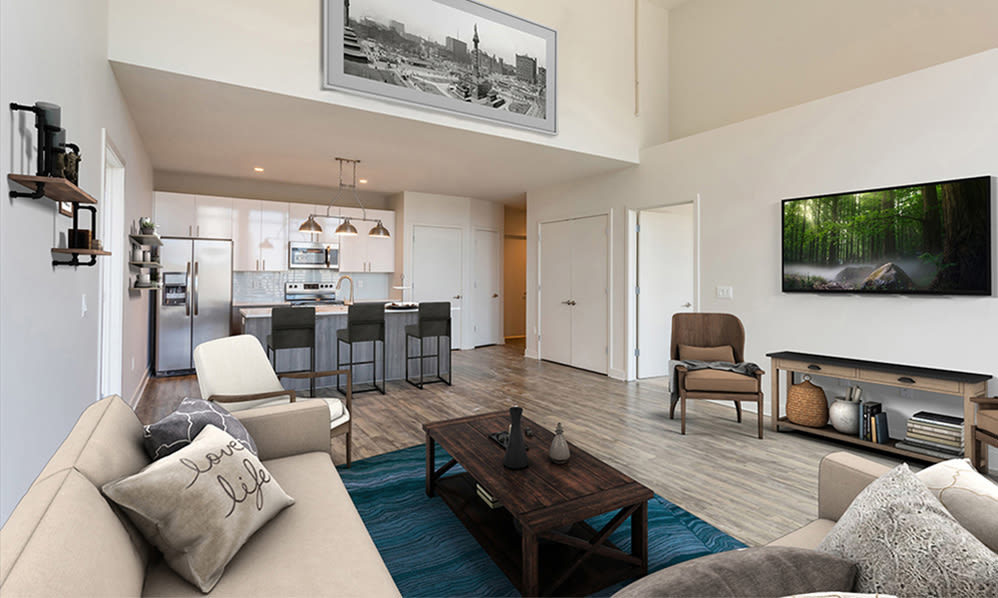 Our The Nathaniel apartments in Rochester, New York showcase a spacious living room