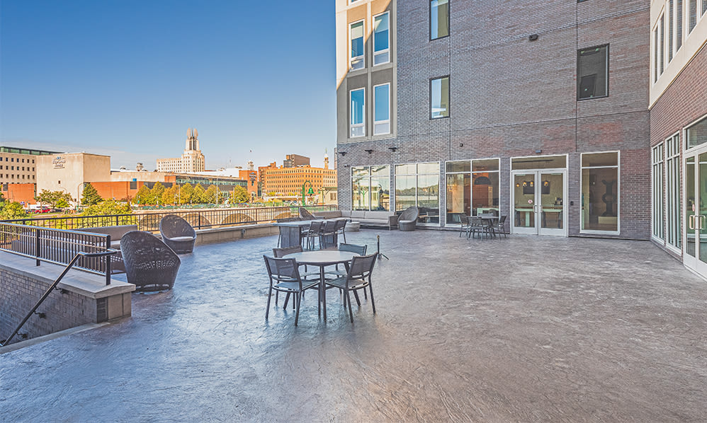 Outdoor patio near the river at The Nathaniel in Rochester, New York
