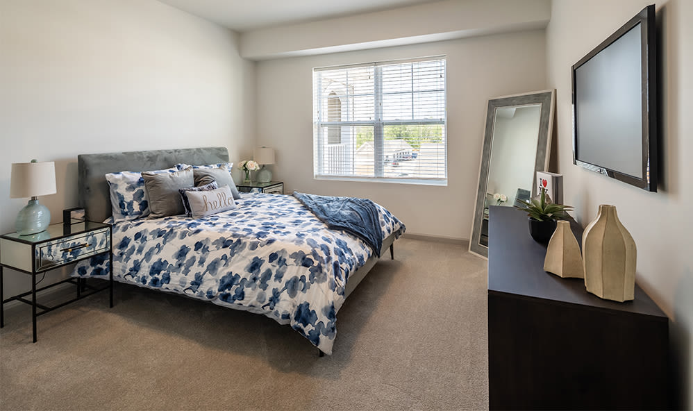 Cozy bedroom at Winding Creek Apartments in Webster, New York