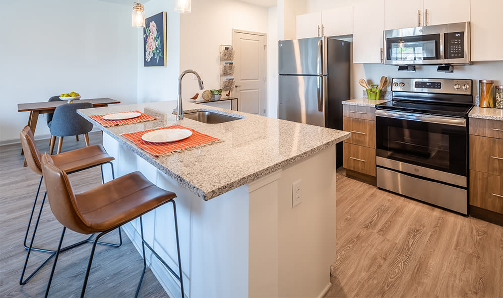 A kitchen that is great for entertaining at Winding Creek Apartments in Webster, New York